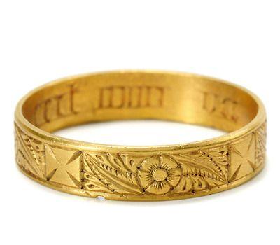 """Early Poesy Ring: ca. 1200-1400, high carat gold inscribed with Lombardic lettering in Norman French """"Ceit Mon Vie"""" with hand-engraved exterior of rose and leaf motifs as well as a cross pattée. """"A poesy ring is embellished with a saying engraved to its interior. Most often signifying a marriage ring, posie rings are typically English in origin with a long history from the medieval era to the 18th century. A few even entered into the 19th century. These engraved inscriptions took many…"""