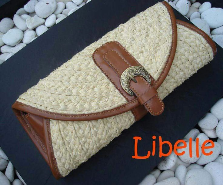 Handwoven agel (natural fiber) clutch combined with leather trim. Magnetic closure...by Libelle Natural Bags.