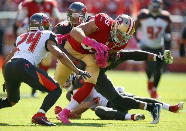Buccaneers vs. 49ers:     October 23, 2016  -  34-17, Buccaneers  -    San Francisco 49ers' Vance McDonald (89) runs after a catch against Tampa Bay Buccaneers' Bradley McDougald (30) and Tampa Bay Buccaneers' Brent Grimes (24) in the first quarter of an NFL game at Levi's Stadium in Santa Clara, Calif., on Sunday, Oct. 23, 2016. (Nhat V. Meyer/Bay Area News Group)