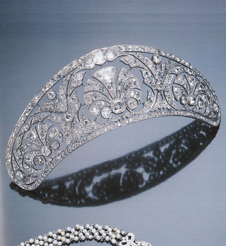 A Belle Epoque diamond diadem, circa 1910. The tapering band of openwork design, the centre bearing a fan-shaped motif within an open foliate border, decorated with two similar smaller motifs at each side, with floral and foliate clusters in between, set throughout with cushion-shaped diamonds. Sotheby's Magnificent Jewels, St. Moritz, 22 February 1997. #BelleÉpoque #diadem