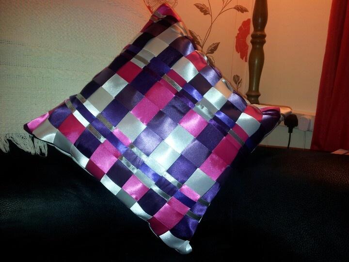 Woven ribbon cushion.