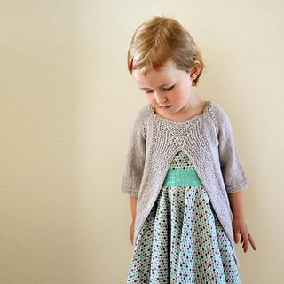 Leksak pattern - top down pullover with cropped sleeves. Worked flat. Sizes ranging from newborn to 10y.