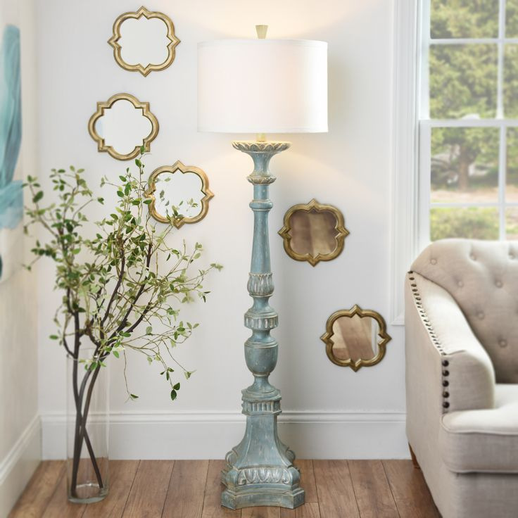 "This lamp may have ""distressed"" in the name but the Alana Distressed Blue Floor Lamp is nothing but serene. Its spindled base, embossed detailing and antiqued blue finish makes this lamp a vintage treasure that all your guests will love!"