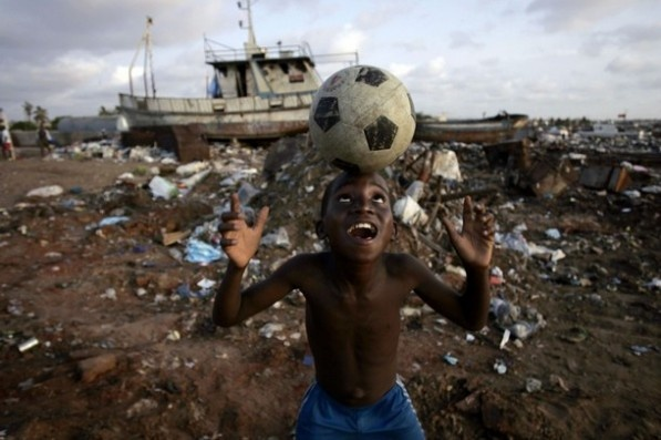 he is so joyous to have just a soccer ball.... oh the things we take for granted!
