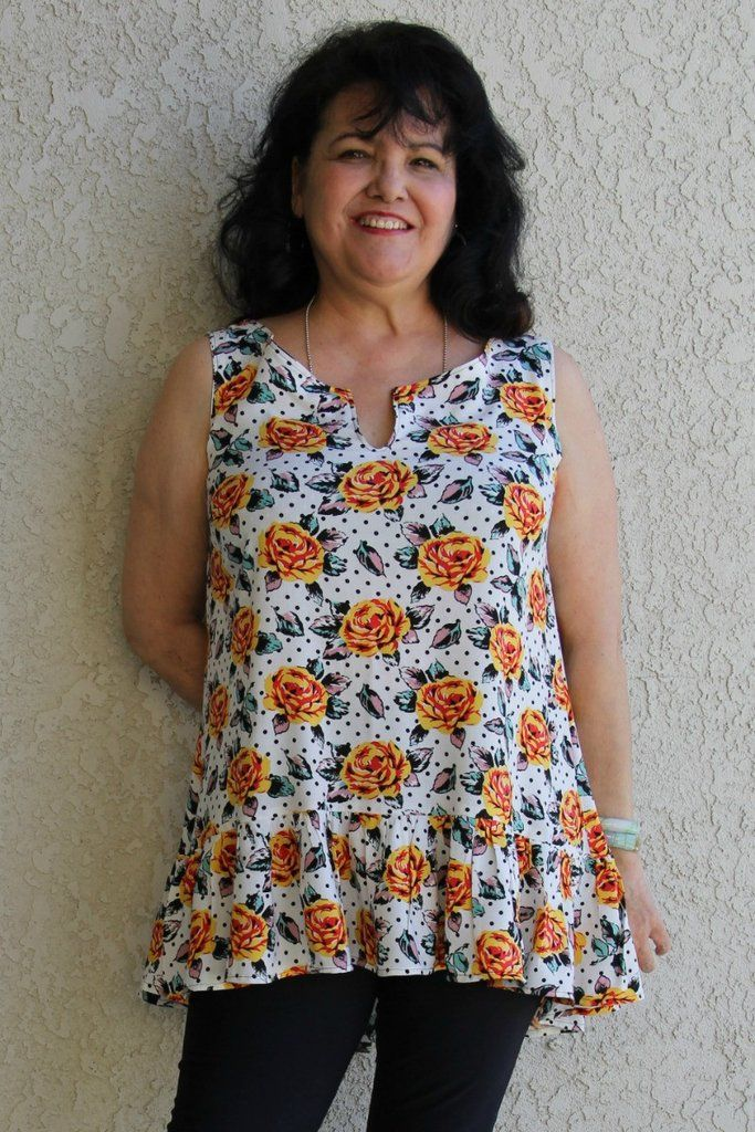 "Summer Breeze tunic PDF sewing pattern.  The Summer Breeze tunic is an easy little sleeveless summer tunic. It's designed with a hi-low ruffle hem, a front slit, bias cut band at the neckline, and binding inside the armscye.   The neckline can be finished with a ruffle instead of a neckband.    This top is great for a warm summer day, but can also be worn under a cardigan or jacket for cooler weather.    Available in sizes US 0-20 and Euro 30-50. Model size 5'6"" 172cm"