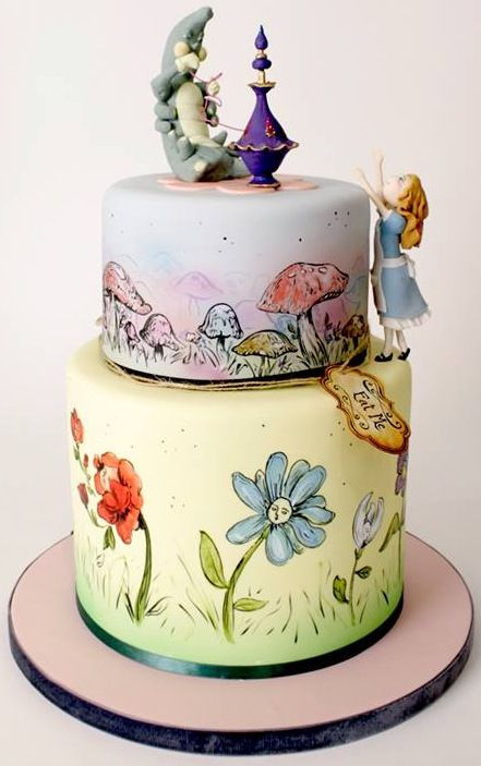 """Stunning Alice in Wonderland Cake with hand painted flowers, mushrooms, and """"Eat Me"""" tag."""