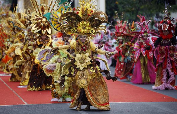 Models present creations made from traditional batik cloth during the Solo Batik Carnival