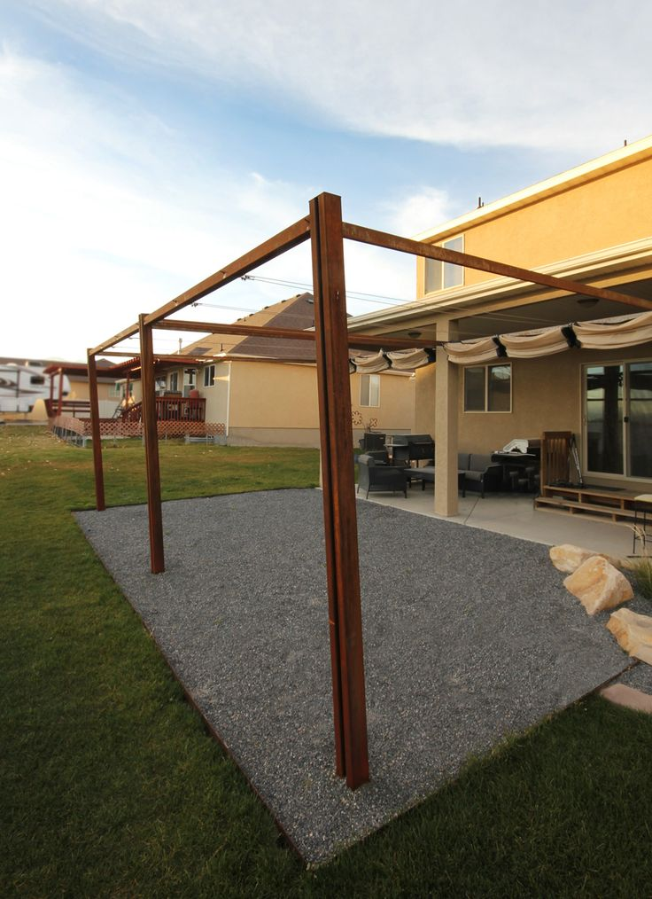A STEEL pergola with retractable shades creates a livable space in an otherwise sweltering south facing yard.