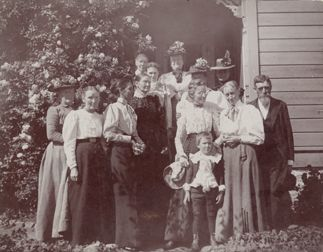 Group portrait of attendees of the first Ladies Aid meeting held in Burbank on June 14, 1900. From left to right: Mrs. H. Westerfield, Mrs. Amanda Van Winkle, Mrs. Burke Kidder, Mrs. Myers, Grace Malissa, Clara Wilcox, Earl Tonison, Mrs. Reverend S. Sprouls, Reverend S. Sprouls, Mrs. Sarah Machus, Daisy Anderson, Grandma Mc Cabe, Miss Sprouls, Mrs. Haddock, and Madelane Sproul.  San Fernando Valley Historical Society. San Fernando Valley History Digital Library.