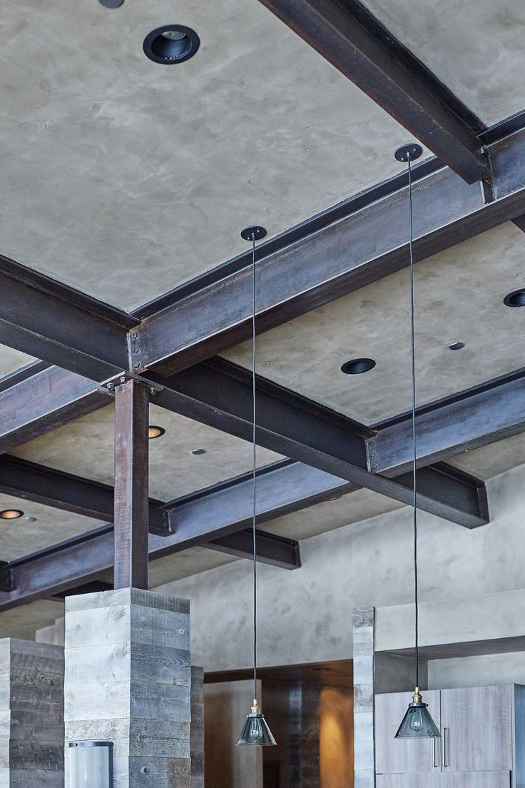 Plaster and steel beam ceiling in mountain modern Big Sky home