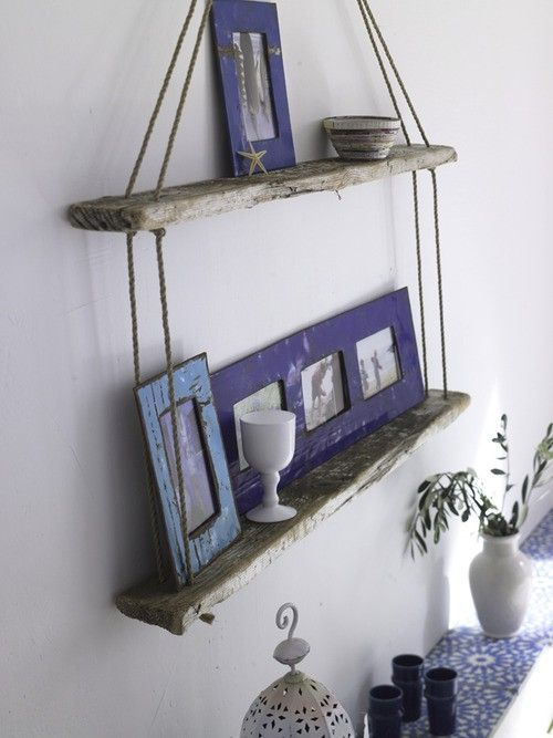salvaged wood; should be hung from a dock cleat with fishing bobbers at the base ( knots )