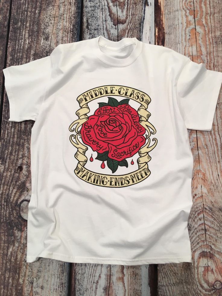 The red rose in our tattoo expresses true and passionate feelings of love and sacrifice. A symbol of the workers whose stories unfold untold every day. The bold, black letters MIDDLE CLASS- MAKING ENDS MEET are proudly displayed on it's banner. Our tee is made from soft, preshrunk, 100% cotton in white. A classic fit of exceptional quality with taped neck and shoulders and double needle stitching throughout. Machine wash warm, inside out with like colors. Tumble dry medium. Do not iron.