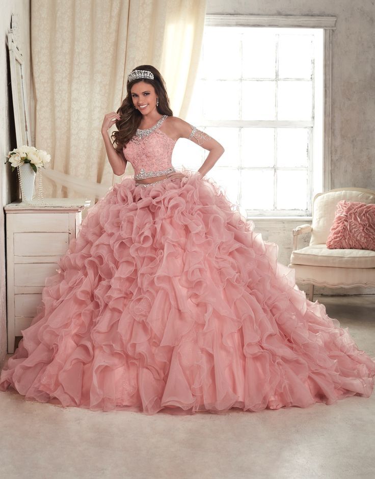 <>House of Wu Quinceanera Dress Style 26813 is made for Sweet 15 girls who want to look like a beautiful Princess on her special day. For a night of celebration, choose this modern two-piece gown with