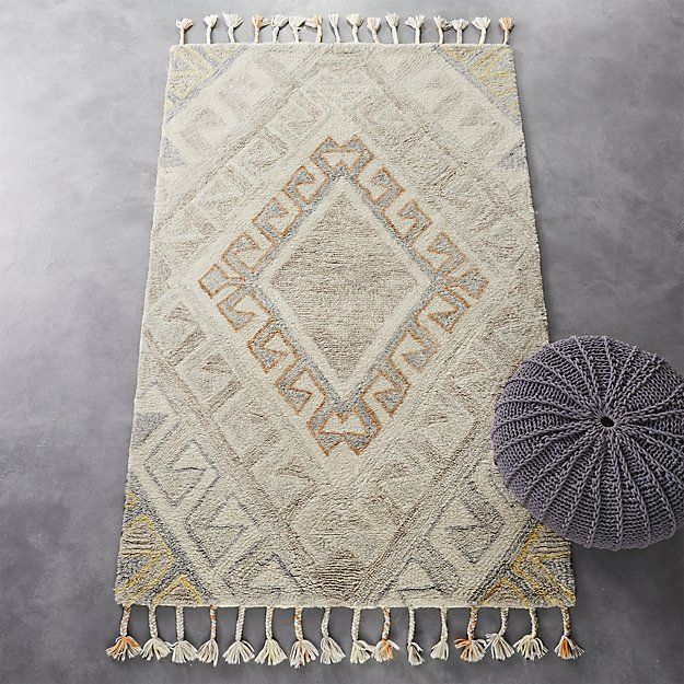 Shop faded shag rug 3'x5'.   Faded graphic rug rolls out in tonal grey with hints of orange and yellow creating concentric diamonds on a natural cream field.