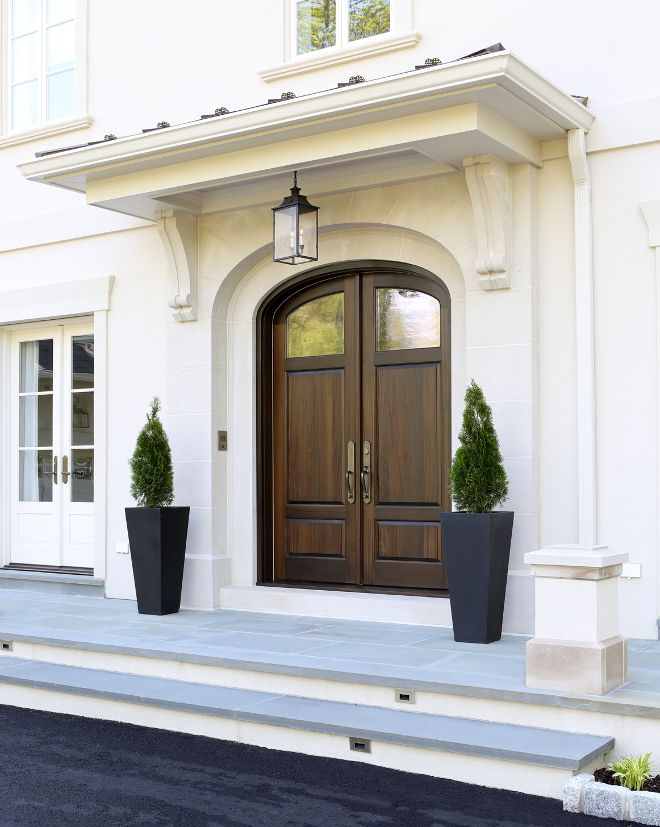 Front Door. The Front Door Features A Limestone Surround With A Wrought  Iron Hanging Lantern