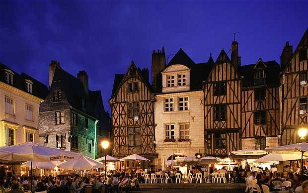 Place Plumereau, Tours, in the Loire Valley, France.  Great people watching a beautiful city.
