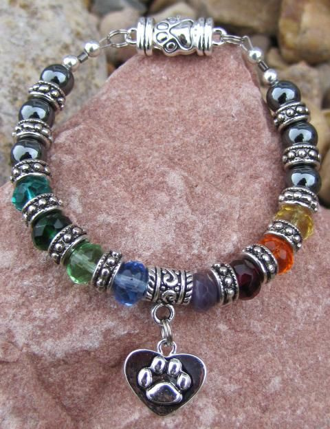 "Rainbow Bridge Silver Lining Pet Memorial Bracelet - in honor of all beloved animals who have crossed over to the Rainbow Bridge.  It's hard to believe that after losing a cherished furry family member and friend that we will ever love another, ever smile again, but God's creatures have a way of opening our hearts to another, when it is perfect timing.  ""When it looked like the sun wasn't going to shine anymore, God put a rainbow in the clouds.""  ~ Maya Angelou. $45.00, with a charity donati..."