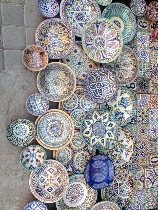 A wall of ceramic plates in Marrakesh, Morocco (photo by Brandon Mably, Kaffe Fassett Studio)