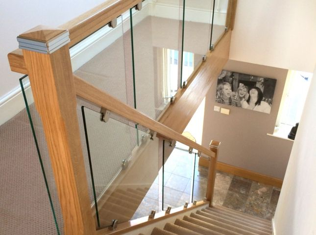 Toughened glass stair balustrade with solid oak rails