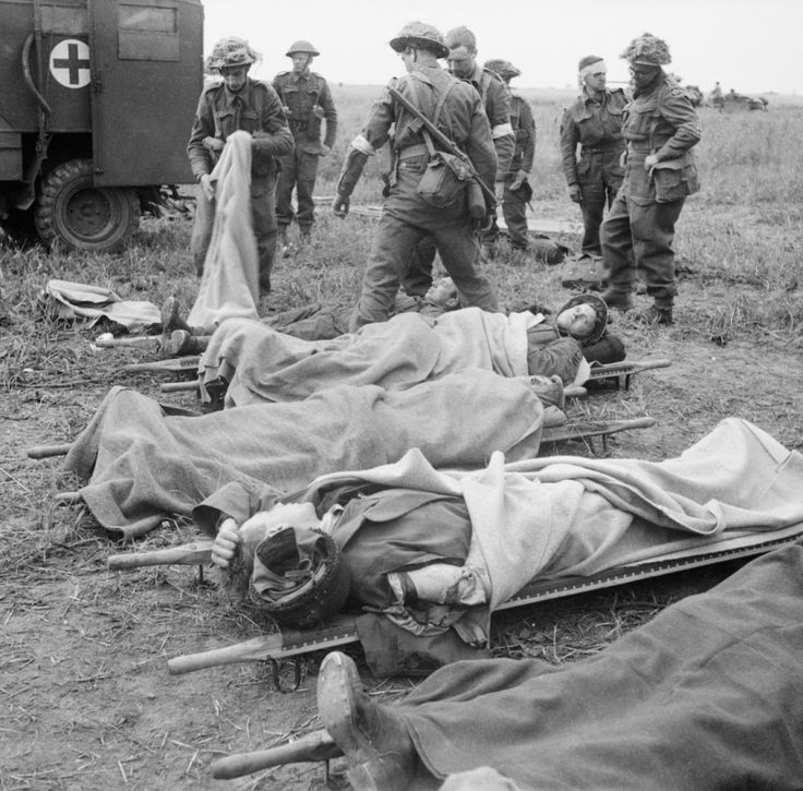 Wounded from 15th (Scottish) Division being collected at a Regimental Aid Post (RAP) during Operation 'Epsom', 26 June 1944. From here, men were transported back to a dressing station for further treatment, and then to a casualty clearing station and evacuation to hospital. The division suffered a total of 300 killed, and over 2,000 wounded or missing during the offensive.