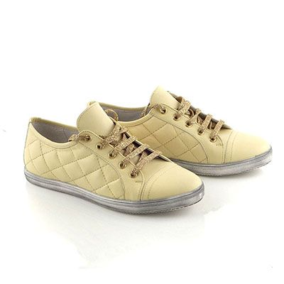 Light yellow sneakers with special gold laces