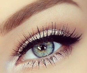simple eye makeup with champagne pink eyeshadow and medium brown in crease and white to brighten up the eye.