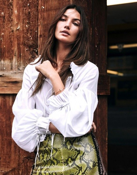 Lily Aldridge wears a white peasant blouse with a snakeskin skirt | Image via whowhatwear.com