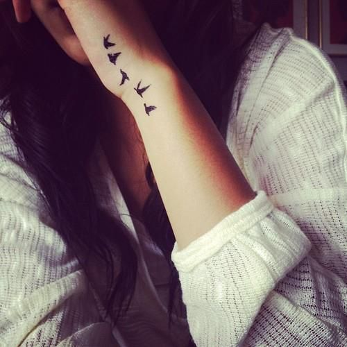 the next tattoo I want involves birds, and my wrist. I like this one :)