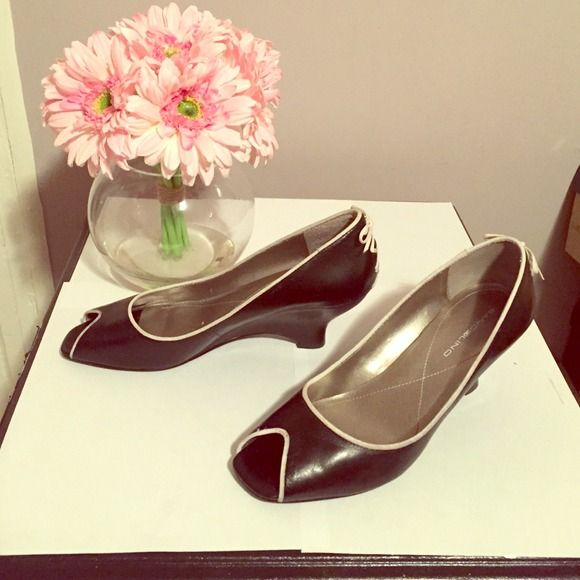 Black and white wedge shoes Worn a few times still in great conditions! Bandolino Shoes Wedges