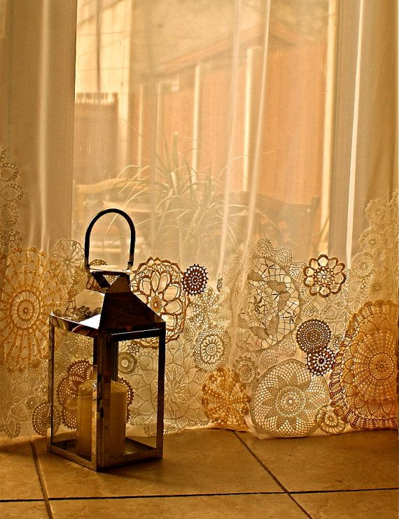 Doily curtains...my mom has a ton of vintage doilies. She should do this.