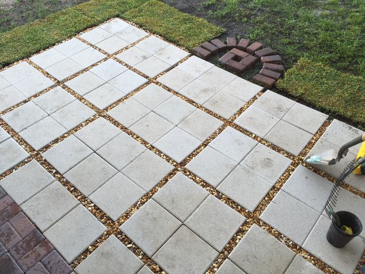 Almost done...Paver patio DIY! 12x12 pavers with gravel between them. I put some gravel under the pavers to help with drainage. The FL ground is sandy already so I didn't add sand underneath. Make sure to use a level to keep the slope away from your house. I had a pile of red bricks left so I made a design that will be a great spot for a fire element! I just need another bag of gravel or two, some seating and hot chocolate!