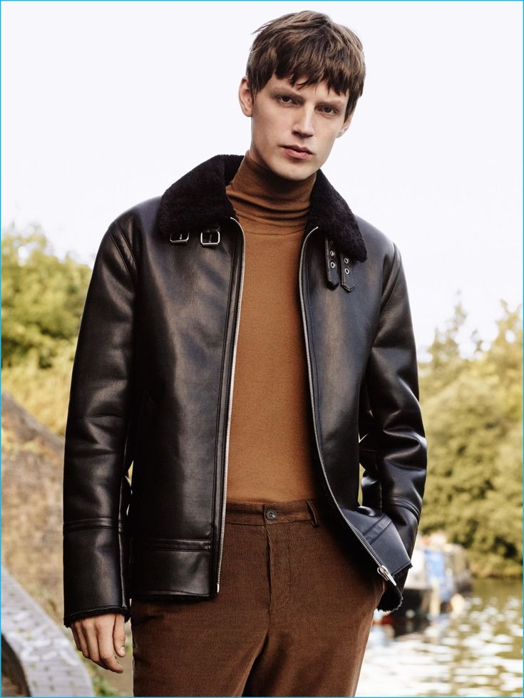 English model Callum Ward sports a faux leather jacket with a turtleneck and corduroy pants from Zara Man.