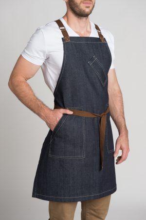 The Apron Studio. Bib denim apron with brown trim.