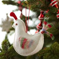 Pretty Felt Partridge Christmas Ornament from BHG. Snow-white felt and colorful scraps are all you need to craft this handmade Christmas ornament.