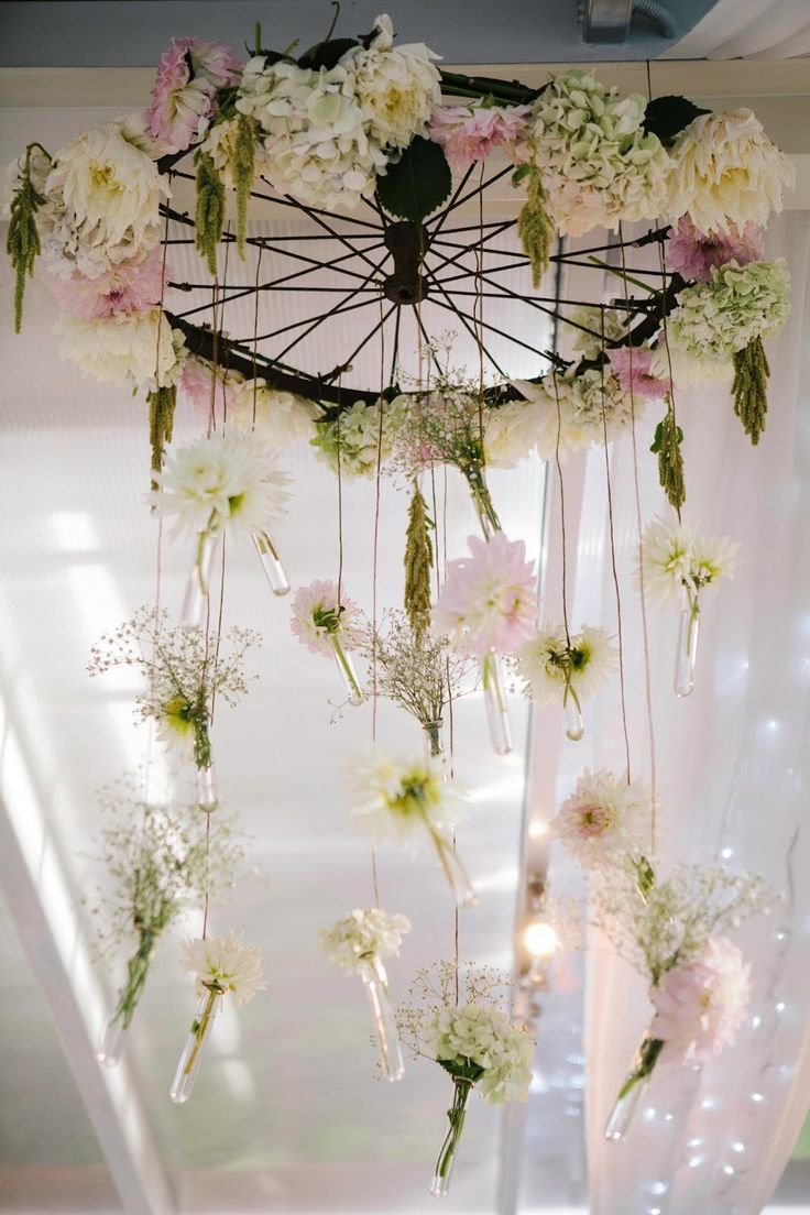 Bicycle wheel chandelier. I like the idea. Perhaps not the flowers.
