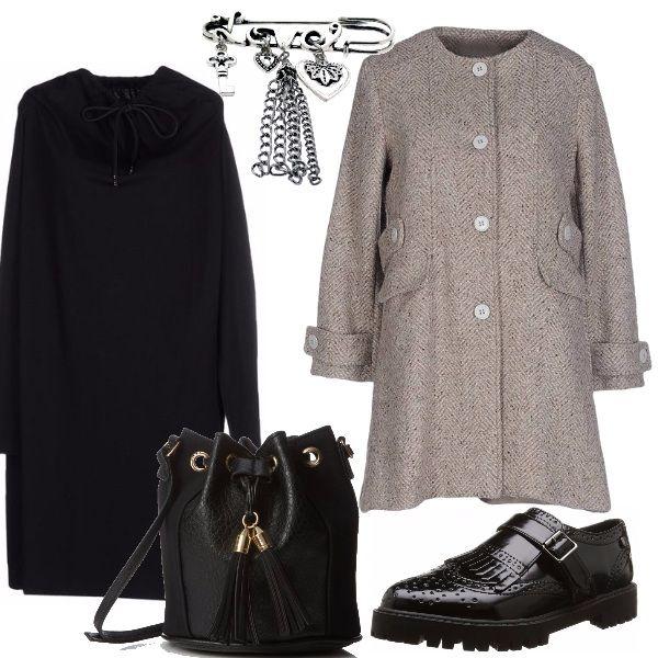 Il cappottino spigato, ben si adatta a delle scarpe di foggia maschile, abbinato al vestito impreziosito dalla spilla, col secchiello con particolari nappine otteniamo un look, femminile ma non banale.