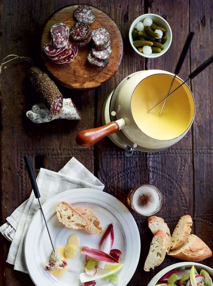 This moreish fondue recipe is made with three different types of cheese, garlic and beer. Pile the accompaniments high and let guests help themselves.