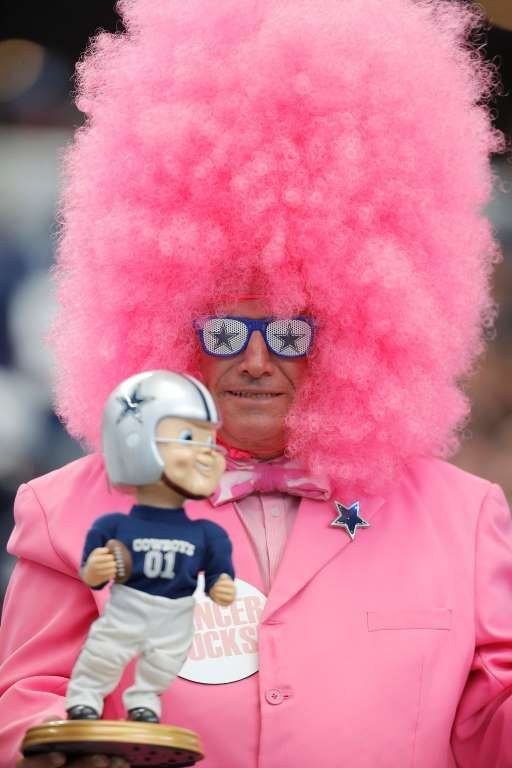 A Dallas Cowboys fan wears pink in observance of Breast Cancer Awareness Month during a game against... - Brandon Wade/AP