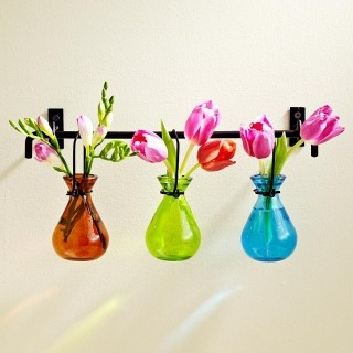 Cool idea for the hanging vases - tie onto a rack.