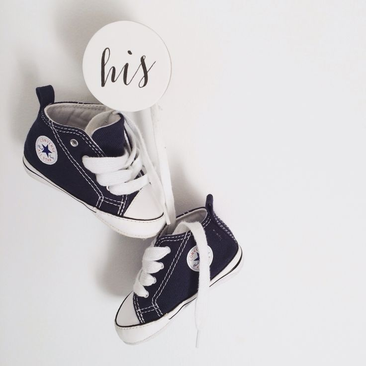 Converse hanging off our 'his' hook