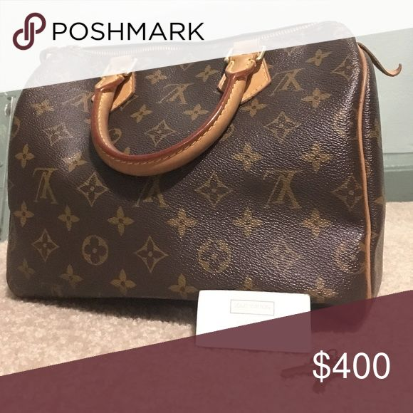 Authentic Louis Vuitton handbag PRICE NEGOTIABLE! I guarantee this is an authentic LOUIS VUITTON Monogram purse. This small tote features vachetta cowhide leather top handles and trim with polished brass hardware. The top zipper opens to a complimentary cocoa brown fabric interior with a patch pocket. This is an excellent classic handbag that is ideal for everyday with the luxury and style of Louis Vuitton! Slightly used, great condition! I have the keys to the lock and the tag to prove it's…