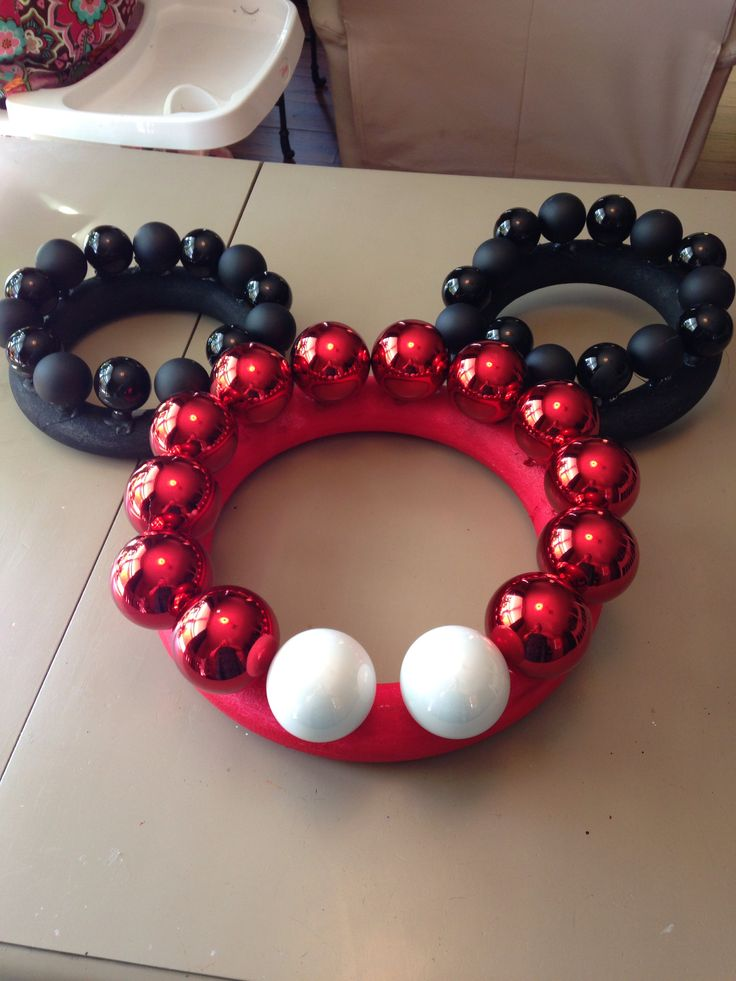 Grab your hot glue gun and make this cute Mickey wreath for practically nothing compared to purchasing in store.