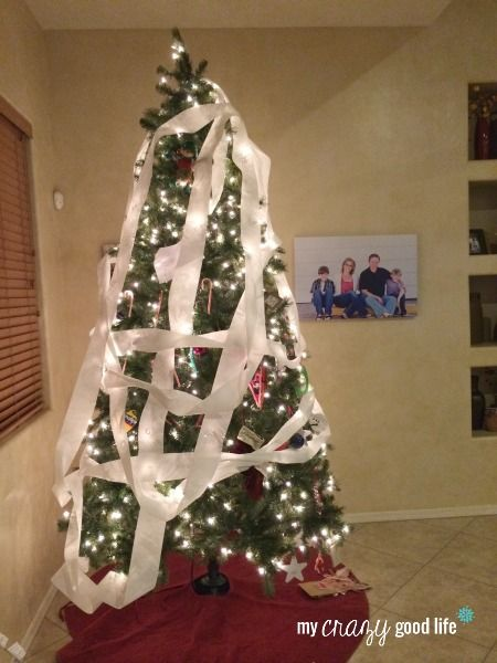 Elf On The Shelf Ideas. This one would be killed by my mom after this. She does such a great job on the tree.
