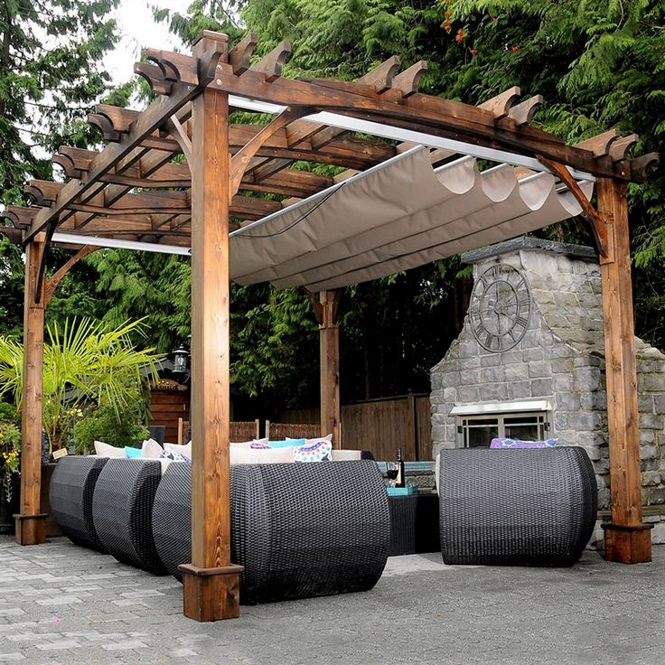 This nice and rustic wooden pergola is beautiful and will surely add purpose to your outdoor sitting area. It has dual option open and covered roof, which can be altered as per desire. The free standing pergola has provision of a vintage stone fire place with a clock which is adding to the grandeur.