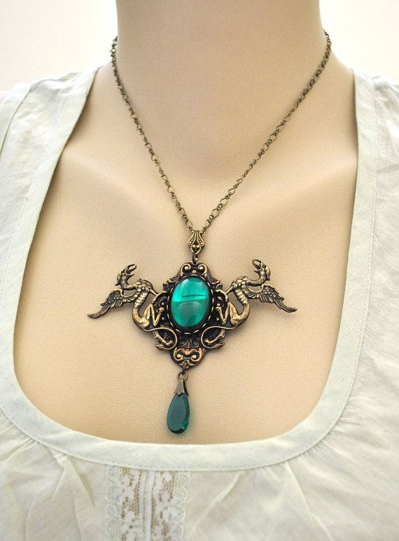 Vintage Emerald, antique brass twin dragon necklace with green vintage Swarovski glass cab from Etsy