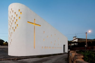 Designed by Póvoa de Varzim based practice e|348 Arquitectura the chapel in Sousanil, Portugal is a physical testament honoring Santa Ana. Located on a triangular plot of land, the small chapel grows from the site like a piece of sculpture.