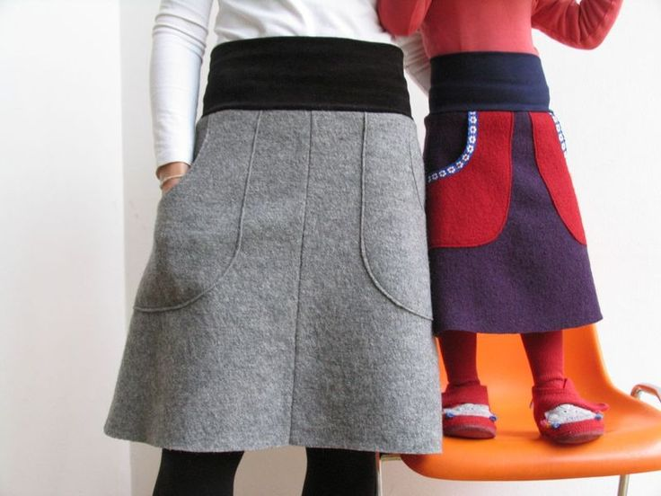 A-line wool felt skirts for girls and moms. would be easy to make. use the charcoal green or the purple black merino that looks and feels like felted wool for this look