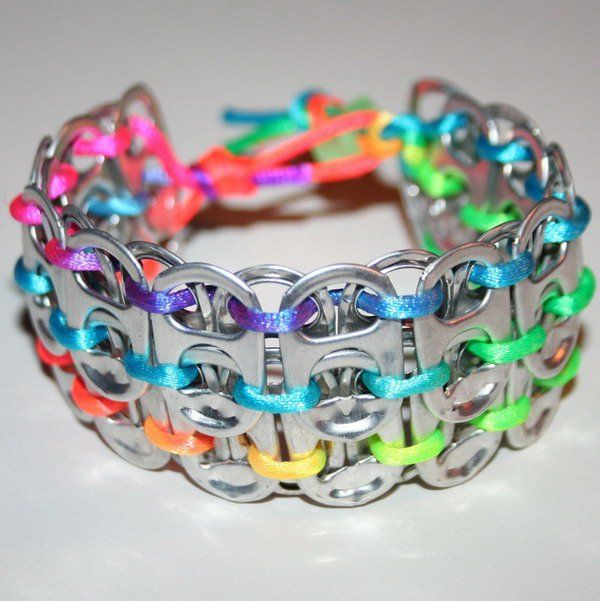 Rainbow pop can tab cuff bracelet. After drinking soda from aluminum cans, you can recycle your soda cans to create interesting projects instead of tossing the empty cans into the garbage or recycling bin.