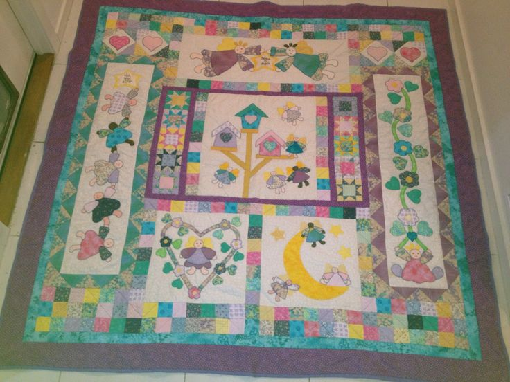Amey's Angel Quilt. Made this a few years ago but only took the photo recently. Appliquéd it by hand!  It would be better quilted now too!