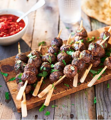 Make these fiery beef kofte for your next barbecue bash, flavoured with an aromatic spice paste and served with a tomato sauce.